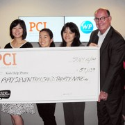 PCI staff with cheque for Kids Help Phone